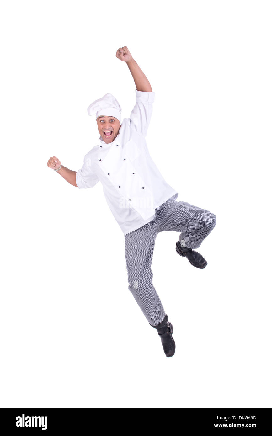 Male chef jumping isolated on white background - Stock Image