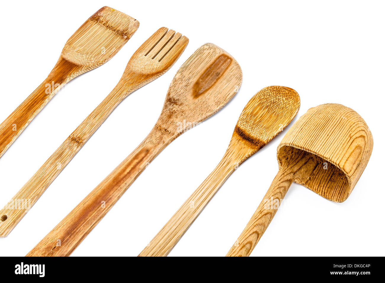 A composition of wooden kitchen utensils a white background Stock ...