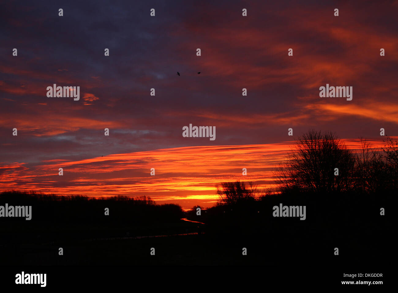 Peterborough, UK. 05th Dec, 2013. Red sky in the morning is said to be shepherds warning, as the sky looks like Stock Photo