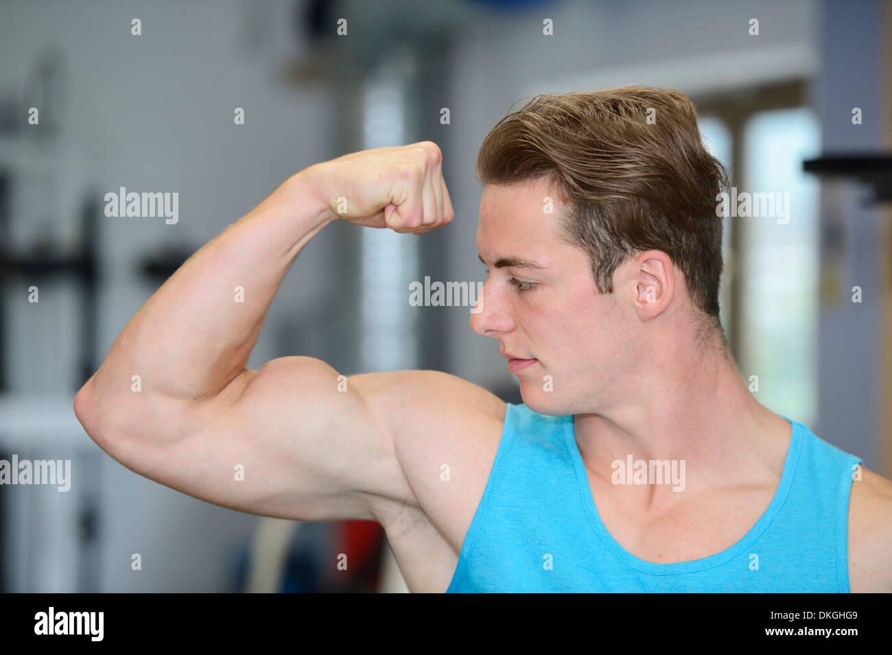 Young man posing in fitness center - Stock Image