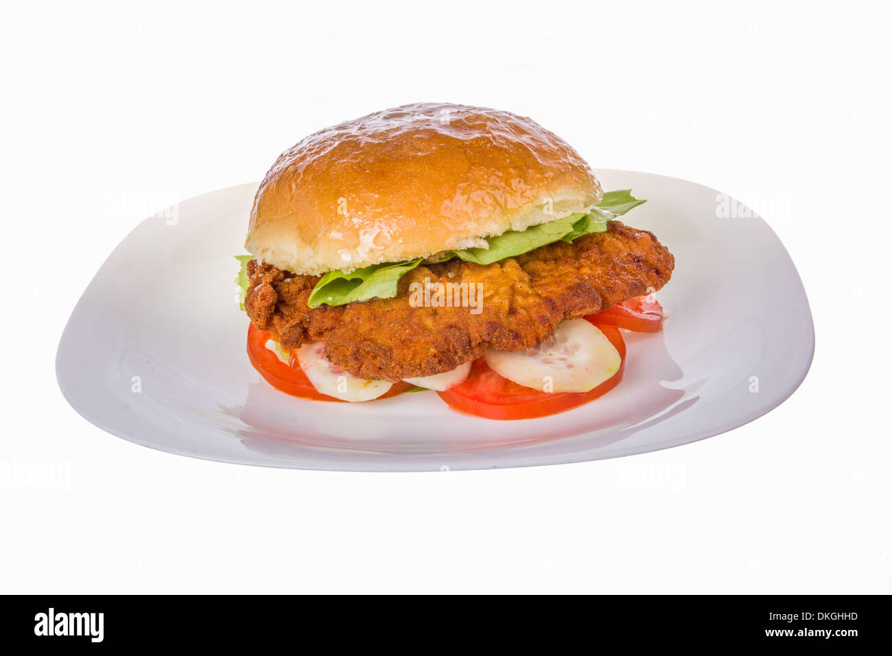 veal in bun with cucumber and tomato and lettuce - Stock Image
