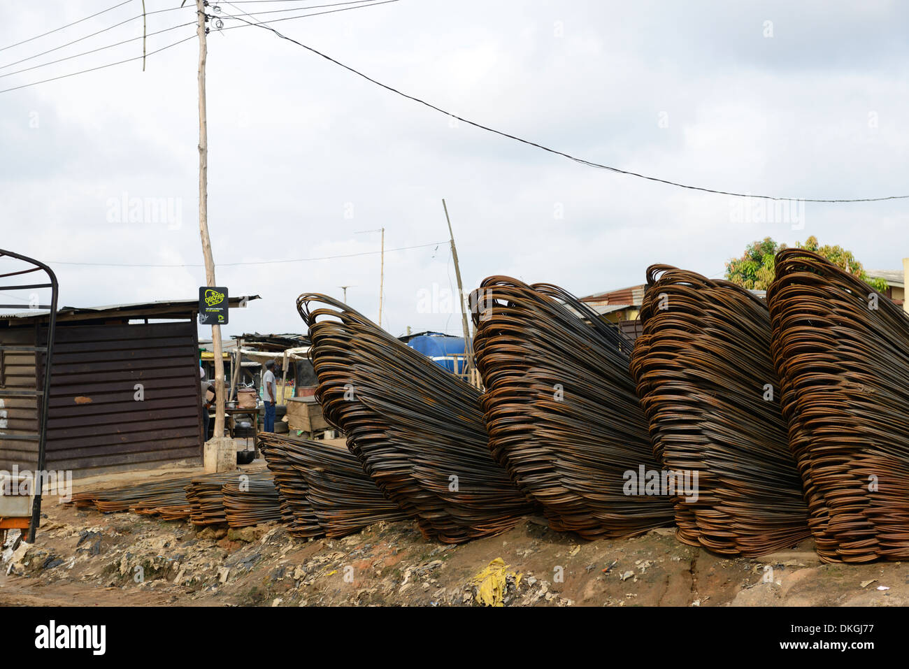 concrete steel bars iron reinforced reinforcement for sale sell market ibadan highway lagos nigeria open air outdoors rusty rust - Stock Image