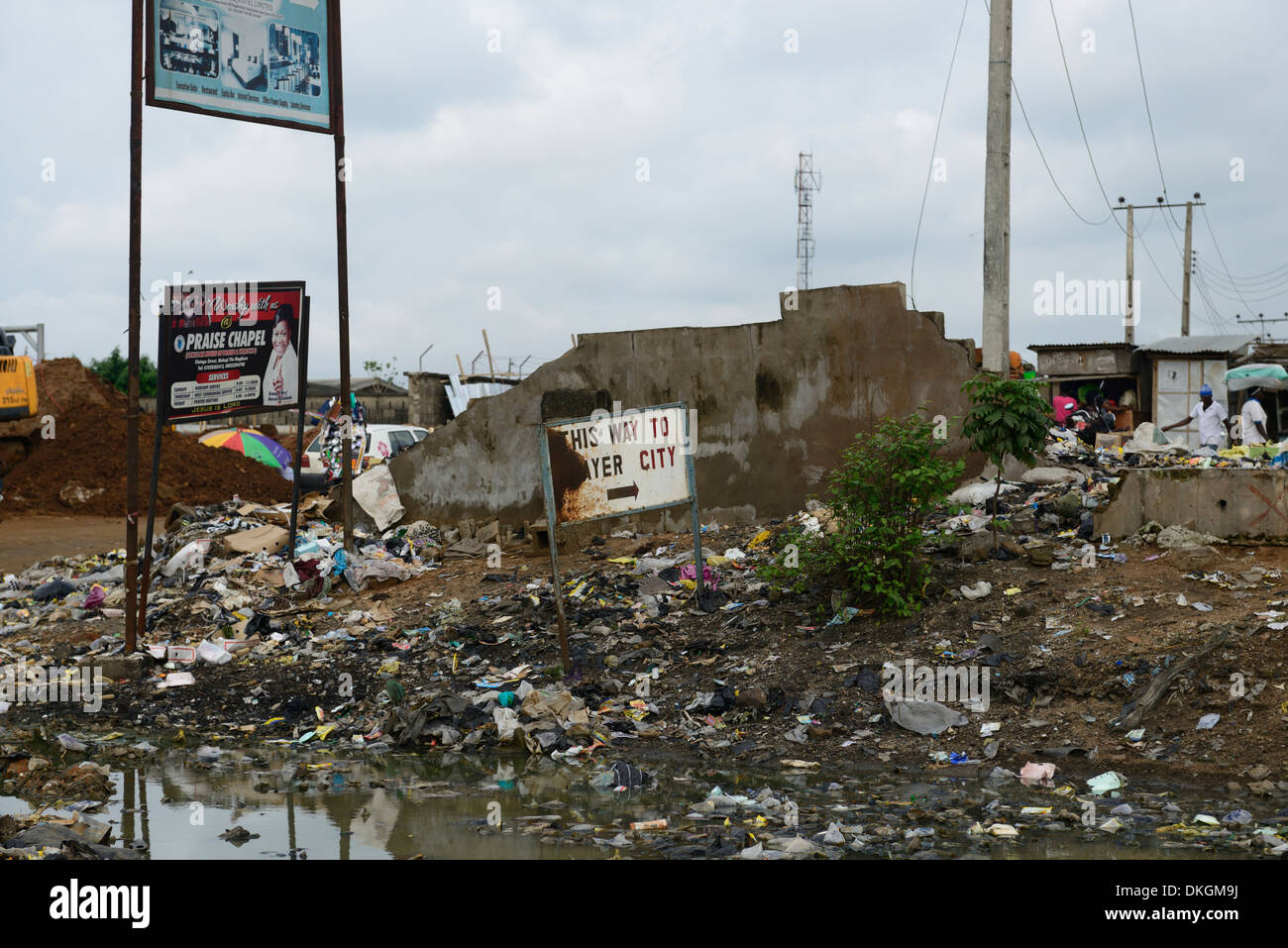 sign signage entrance filth strewn rubbish prayer city ibadan highway lagos nigeria slum slums - Stock Image