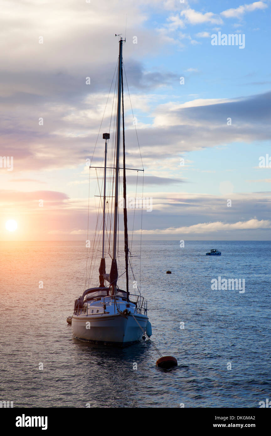 Yacht moored near the historic fishing village of Polperro, Cornwall, England. - Stock Image