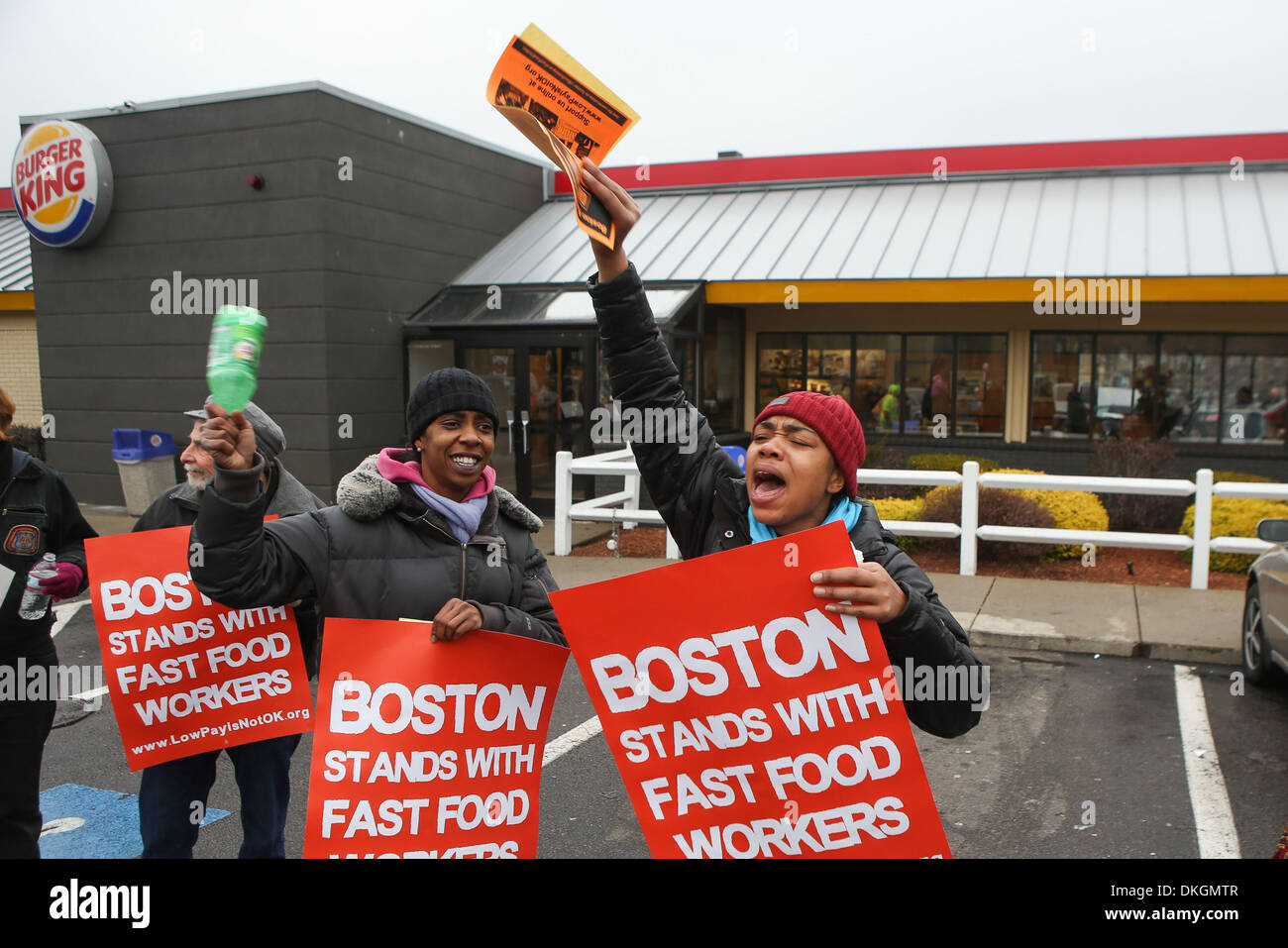 Boston, Massachusetts, USA. 5th Dec, 2013. Dozens rally for higher wages for employees in the fast food industry outside a Burger King in the Dorchester neighborhood of Boston, Massachusetts as similar rallies were held rally across the country for higher fast food employee wages. Credit:  Nicolaus Czarnecki/METRO US/ZUMAPRESS.com/Alamy Live News - Stock Image