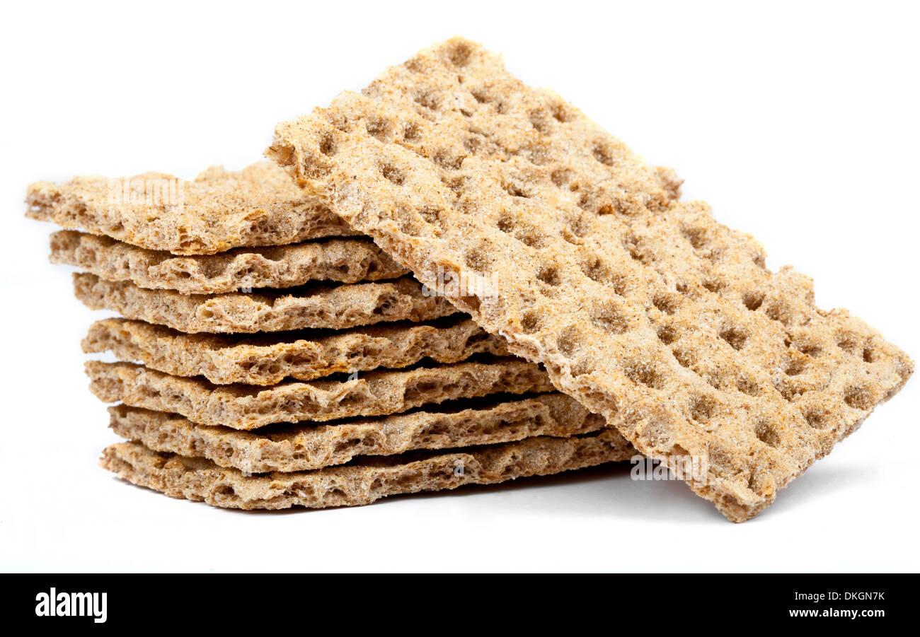 Crispbread over a plain white background. - Stock Image