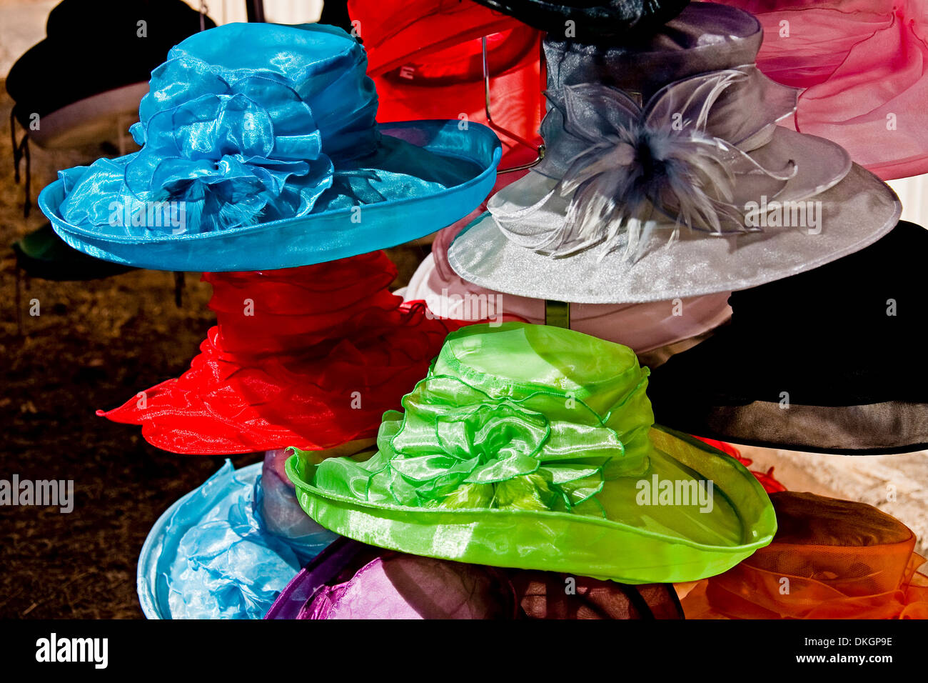 Brightly coloured and decorative women's hats at street market stall in city of Maryborough Queensland Australia - Stock Image