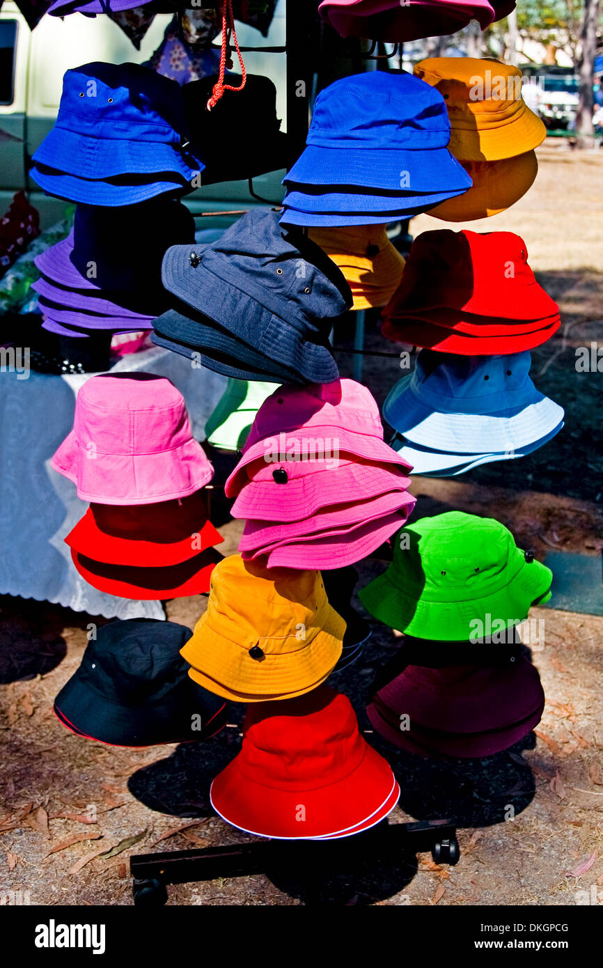 Brightly coloured cloth hats at street market stall in city of Maryborough Queensland Australia - Stock Image