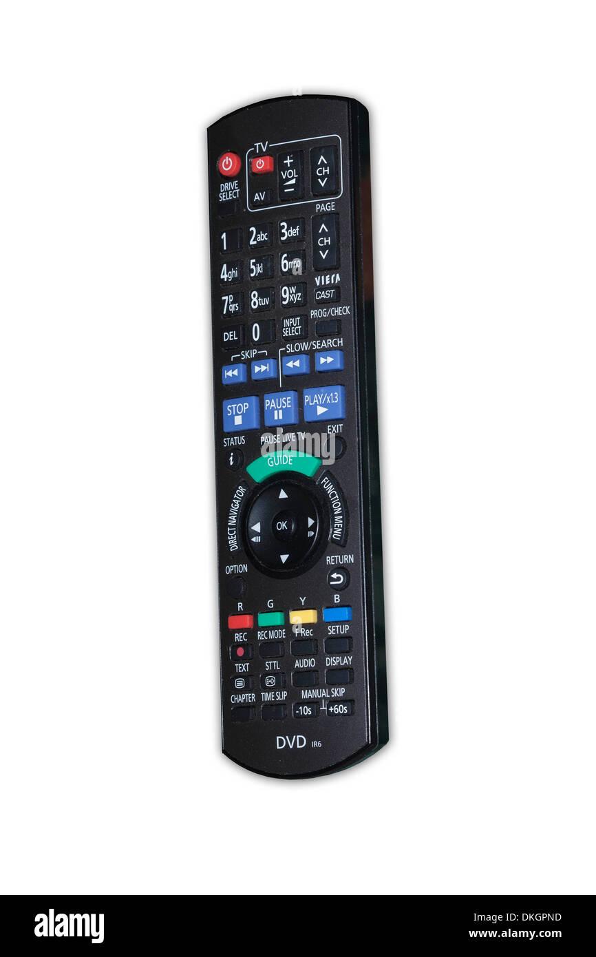 Black hand held DVD / TV remote controller unit  against plain white background - Stock Image