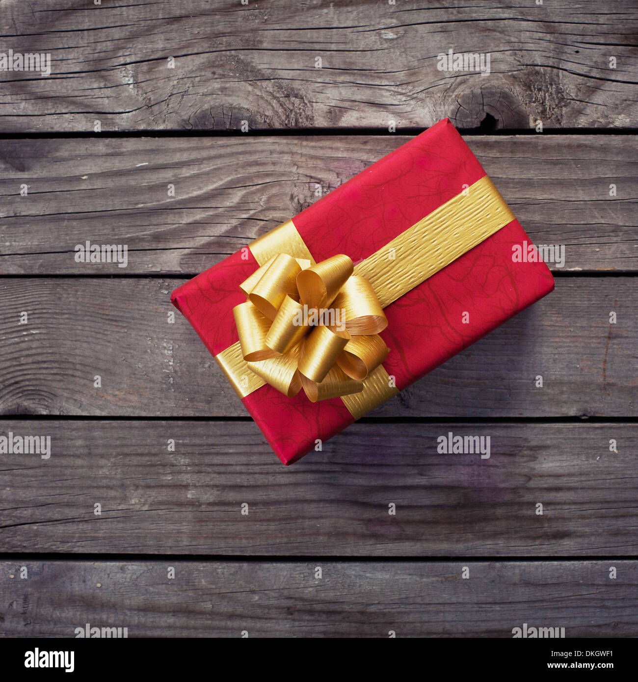 gift on wooden background - Stock Image