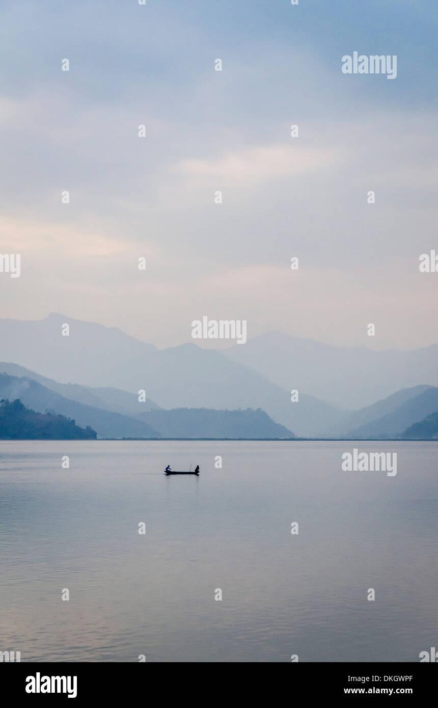 A rowboat on Phewa Tal (Phewa Lake), Pokhara, Nepal, Asia - Stock Image