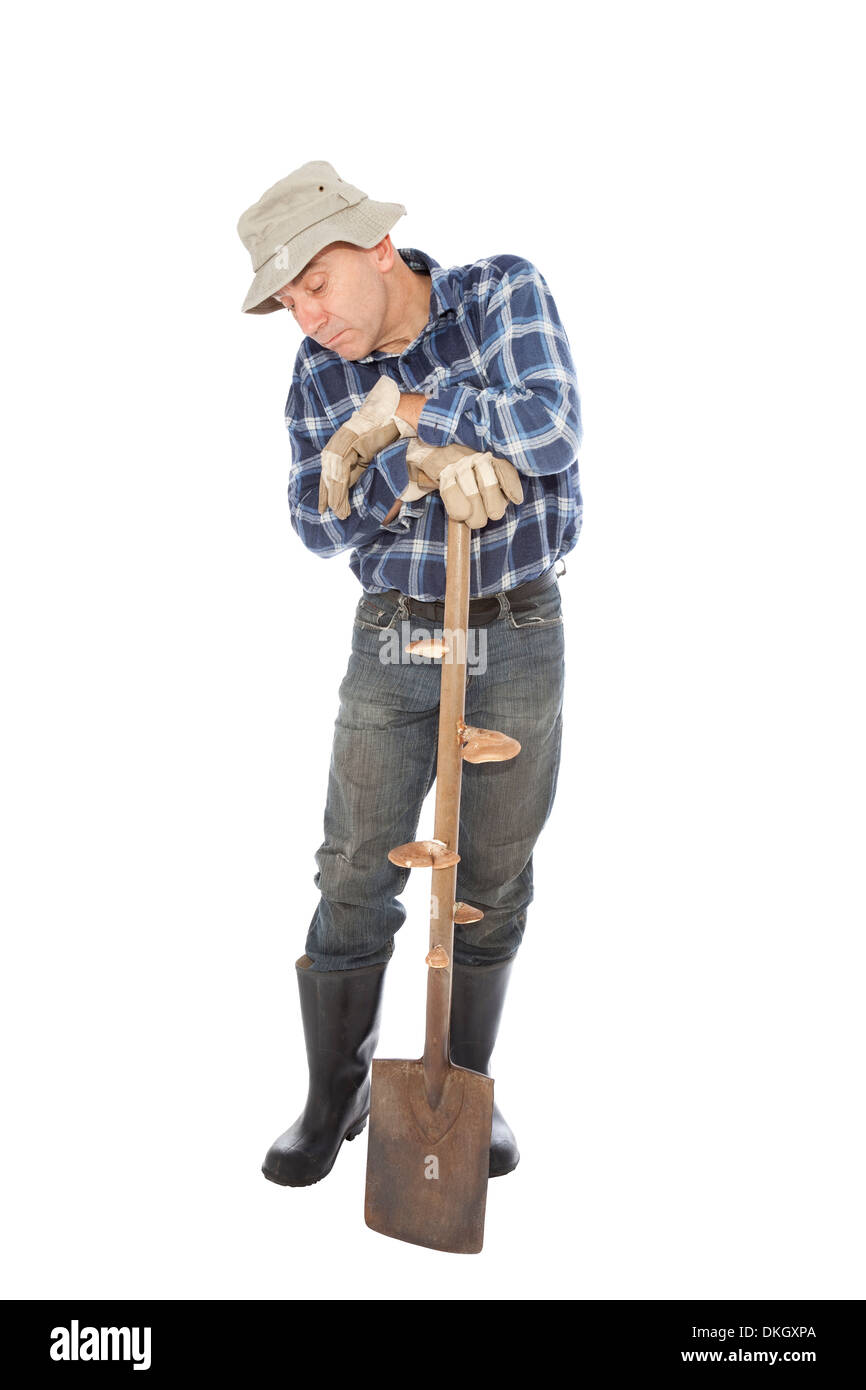 unemployed worker in gloves keeps the spade - Stock Image