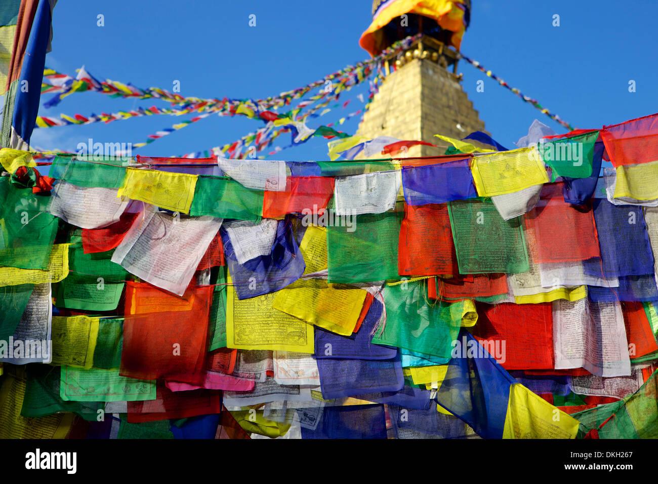 Prayer flags in front of Boudha (Bodhnath) (Boudhanath) Tibetan stupa in Kathmandu, UNESCO World Heritage Site, Nepal, Asia - Stock Image