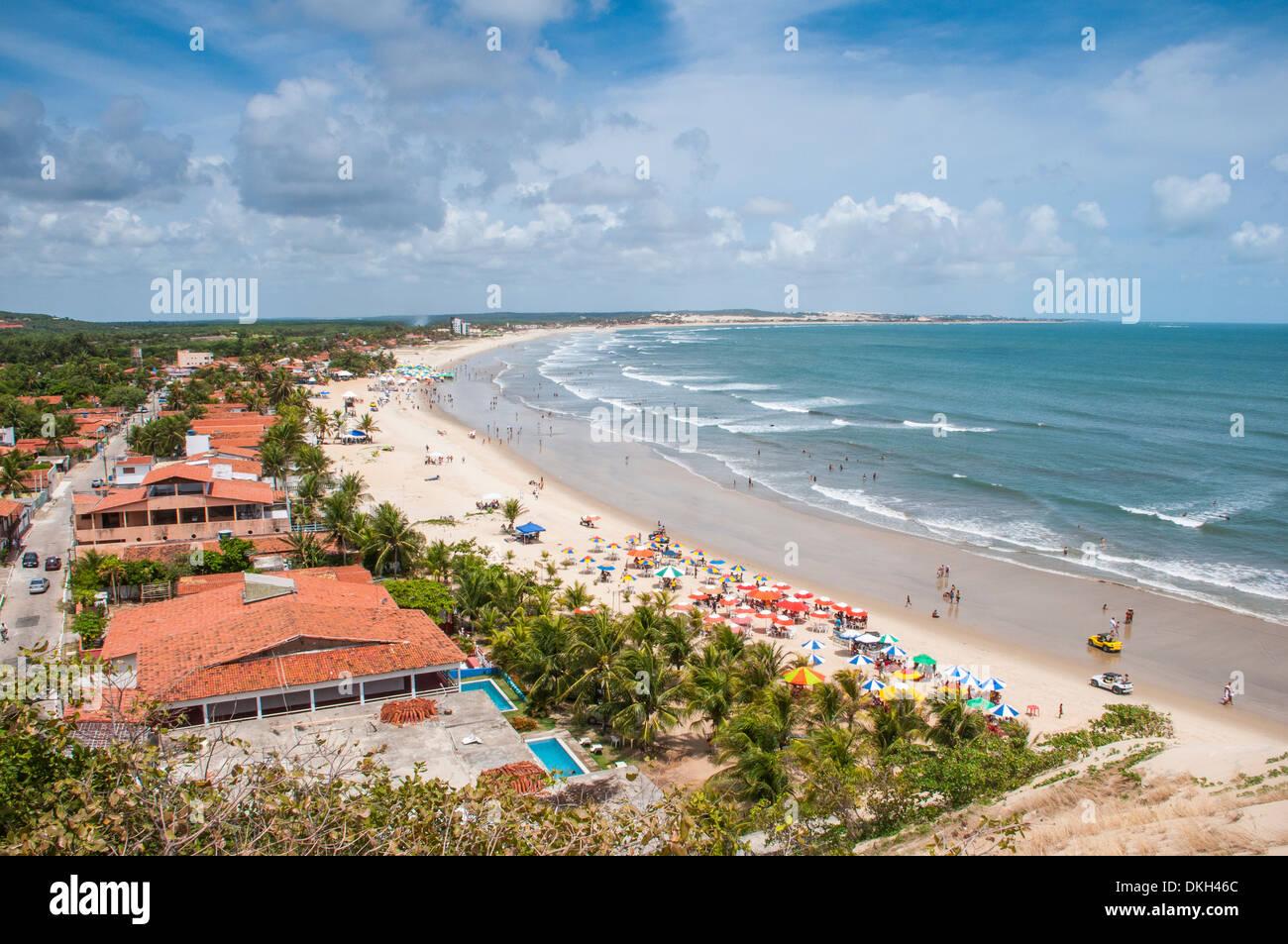 Beautiful beach below the sand dunes of Natal, Rio Grande do Norte, Brazil, South America - Stock Image