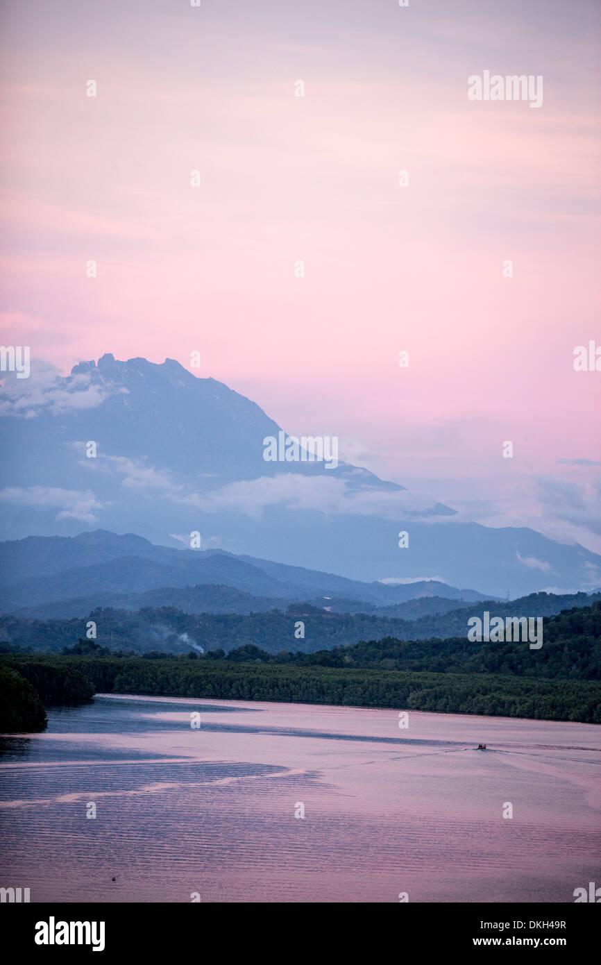 A view of Mount Kinabalu over Menkabong River, Sabah, Malaysian Borneo, Malaysia, Southeast Asia, Asia - Stock Image