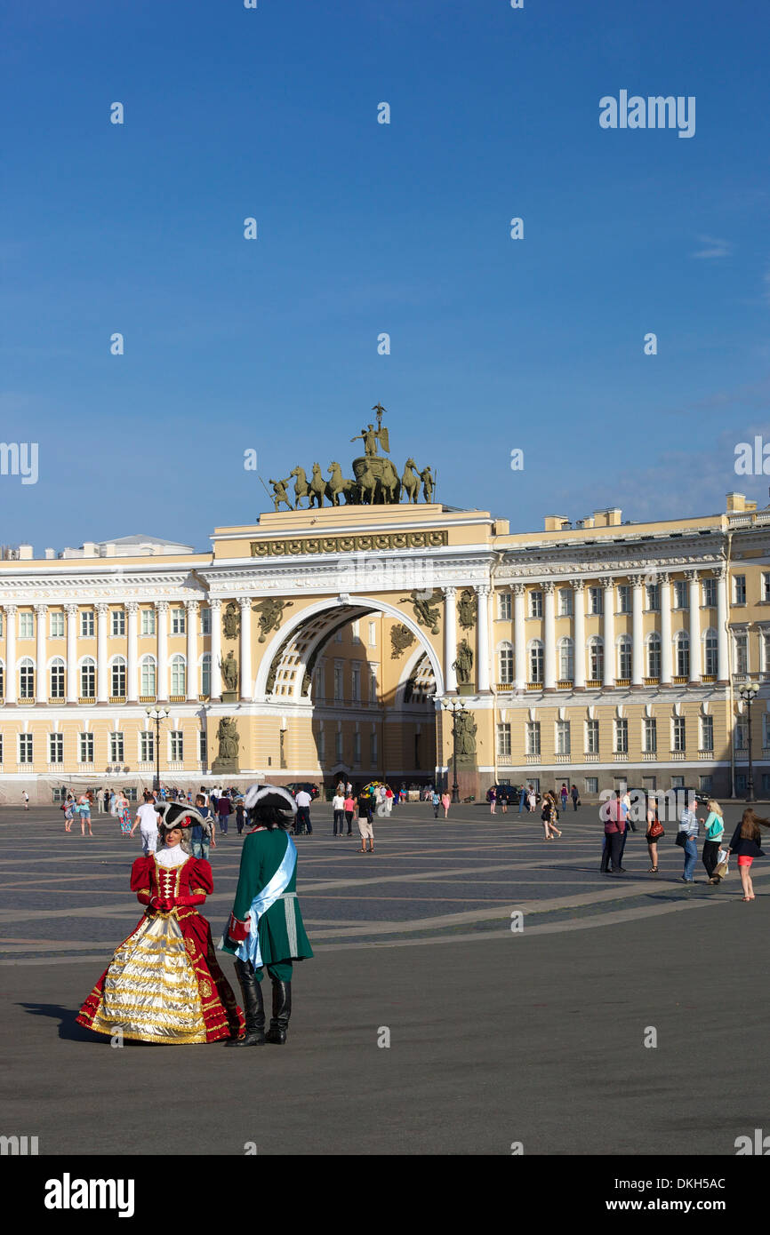 Costumed figures in Palace Square, and General Staff Building, Palace Square, St. Petersburg, Russia, Europe - Stock Image