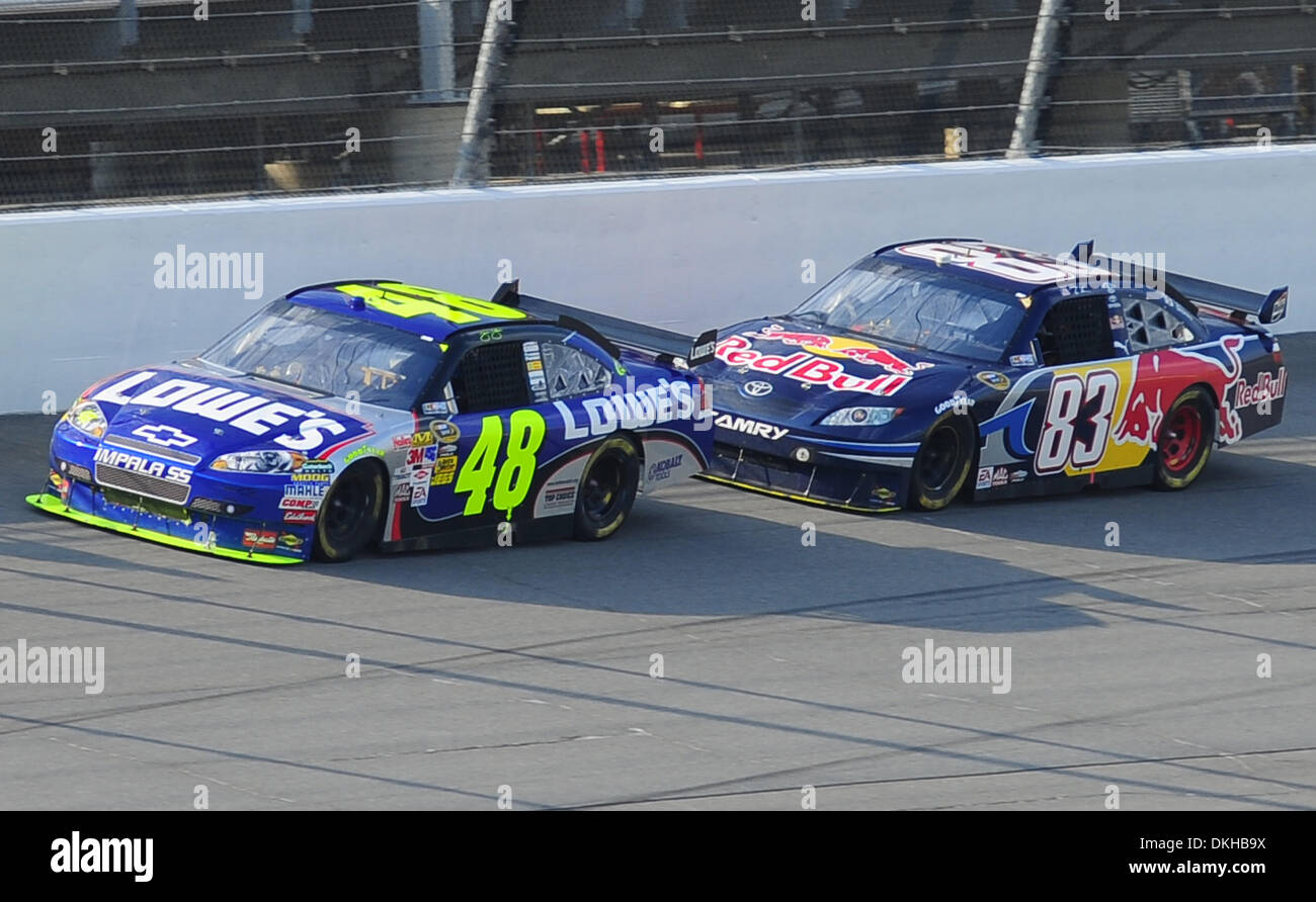race leader jimmie johnson in the lowe's chevrolet leads brian stock