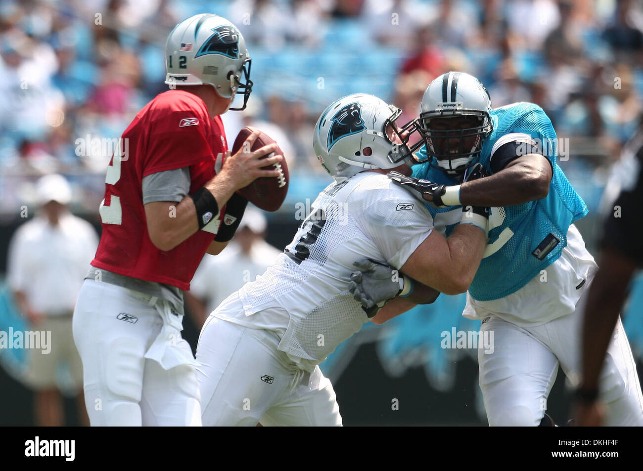 Aug. 8, 2009 - Charlotte, North Carolina, U.S - August 8, 2009:  Carolina Panther quarterback Josh McCown #12 looks for a receiver as guard Justin Geisinger #63 blocks defensive tackle Damione Lewis #92 during scrimmage at the Fan Fest held at Bank of America Stadium in Charlotte, North Carolina. (Credit Image: © Southcreek Global/ZUMApress.com) - Stock Image