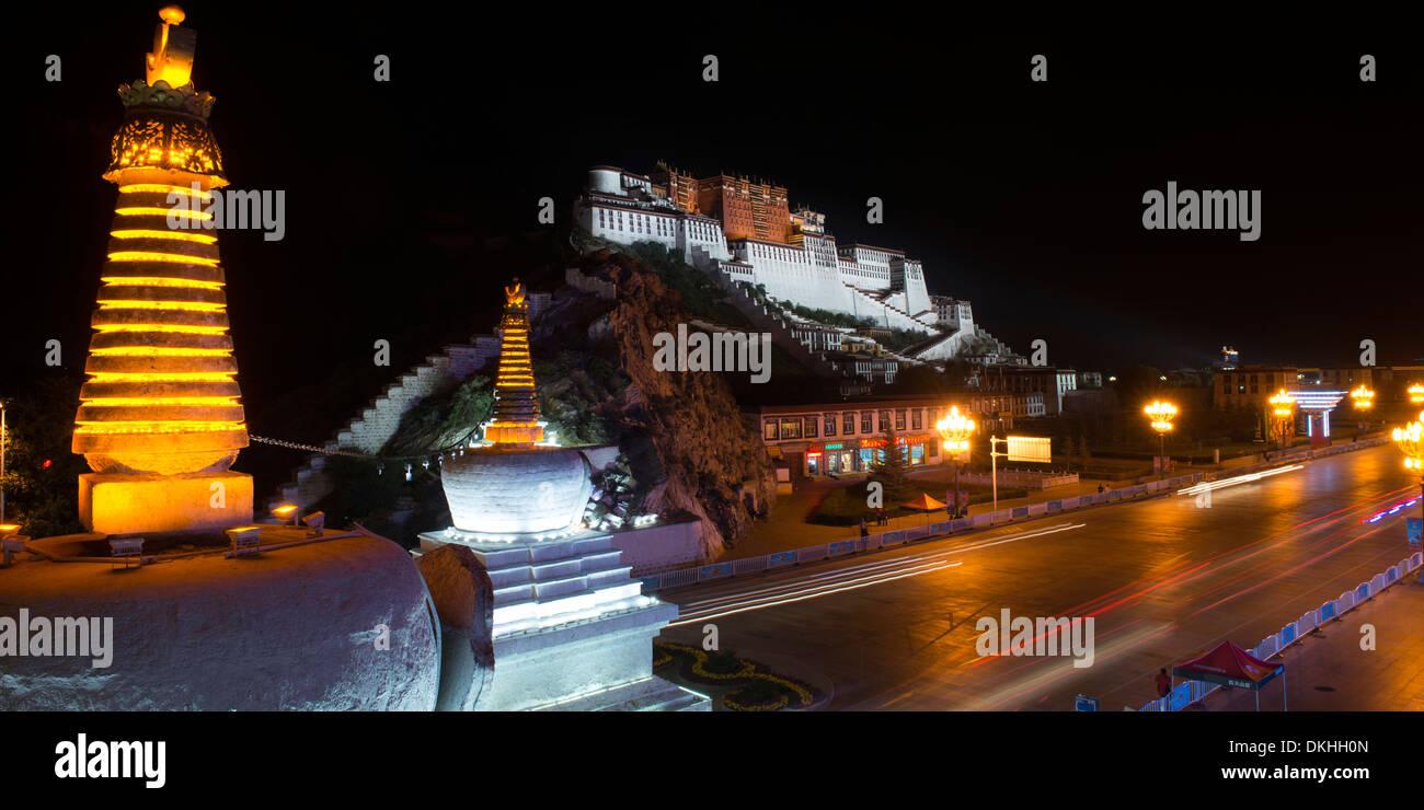 Stupas with Potala Palace at night, Lhasa, Tibet, China - Stock Image