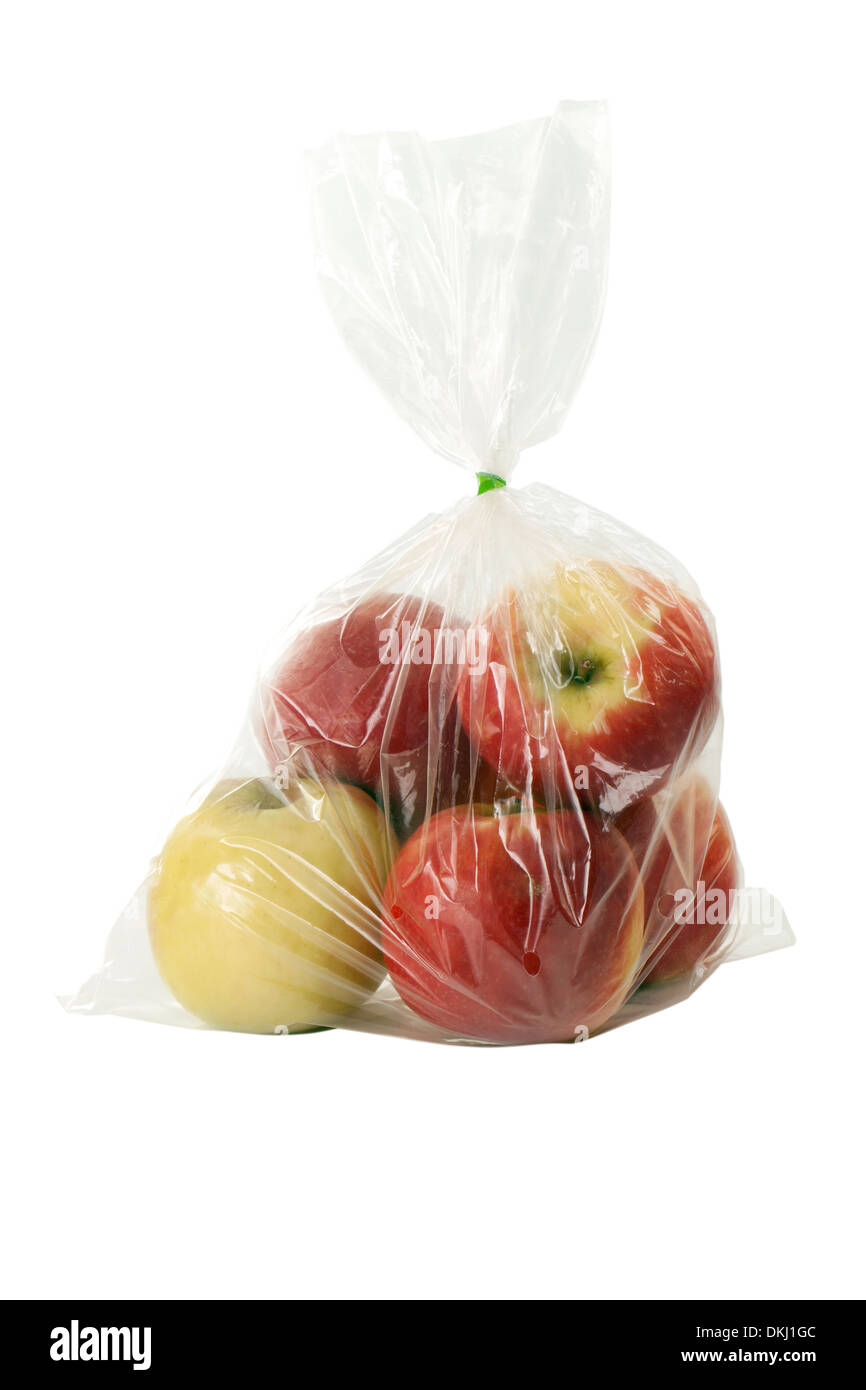 Apple with plastic warp on white background - Stock Image