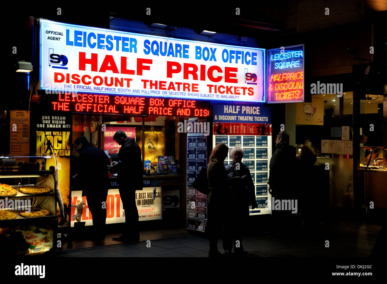 London, England, UK. Leicester Square box office - half price theatre tickets - at night - Stock Image