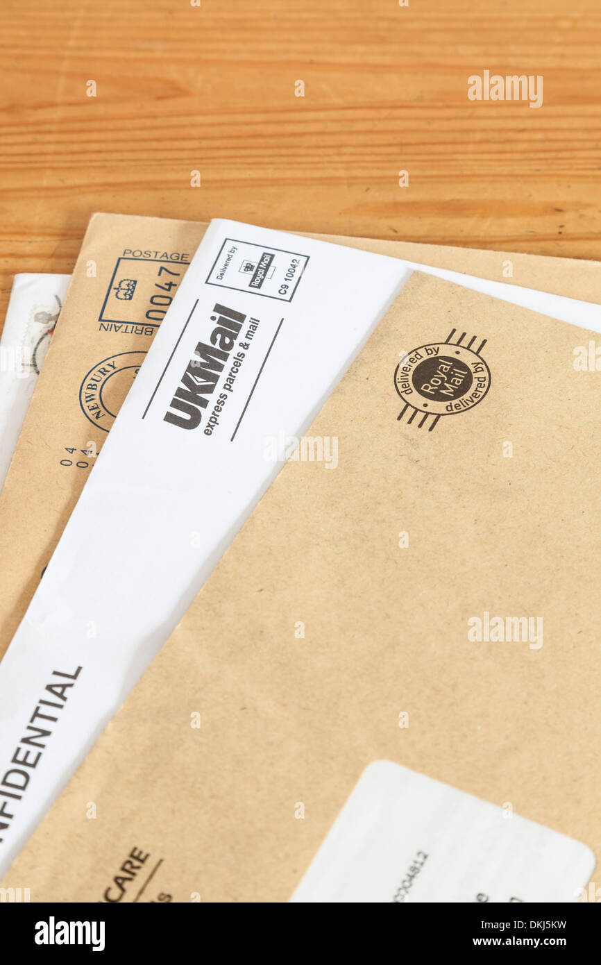 Unopened letters delivered by the Royal Mail - Stock Image