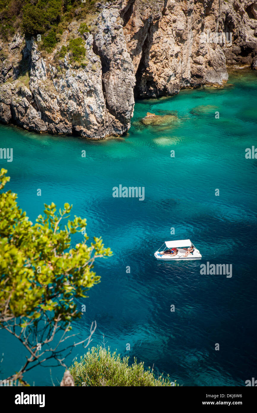Boating in the blue waters off the coast of the Ionian island of Corfu, Greece - Stock Image