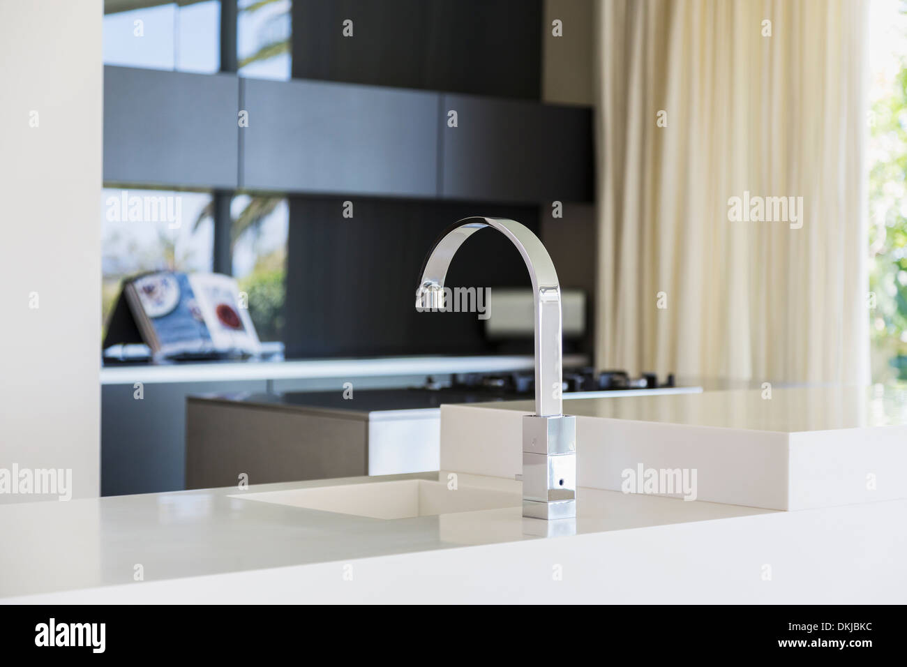 Faucet and sink in modern kitchen - Stock Image