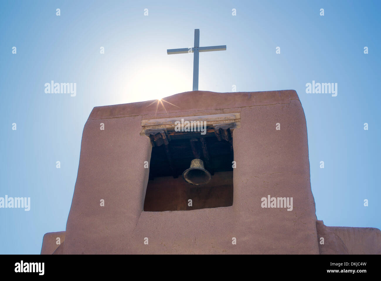 Cross and church bell. San Miguel Mission. Santa Fe, New Mexico. - Stock Image