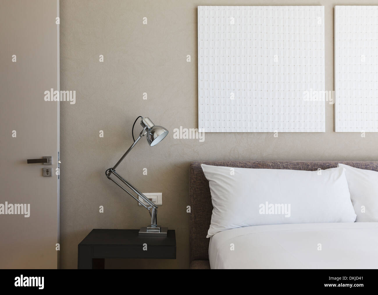 Lamp and wall art in modern bedroom Stock Photo: 63715009 - Alamy