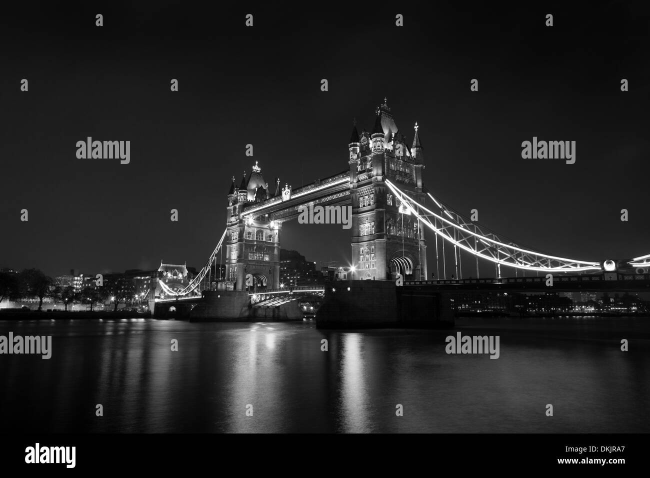 London Tower Bridge at Night B&W rendition, long exposure, over Thames River. - Stock Image