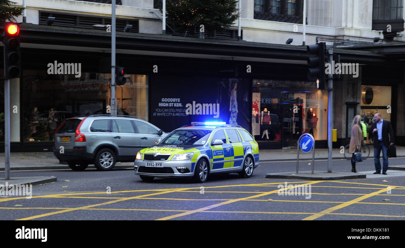 london metropolitan police car with blue lights flashing on
