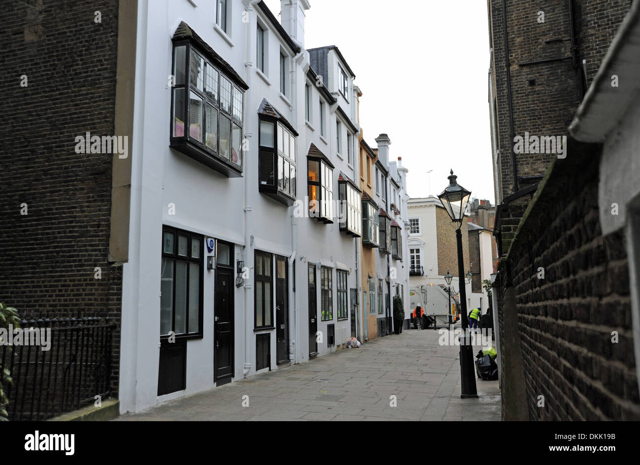 Old cottages in the Royal Borough of Kensington and Chelsea London W8 UK Photograph taken by Simon Dack Stock Photo