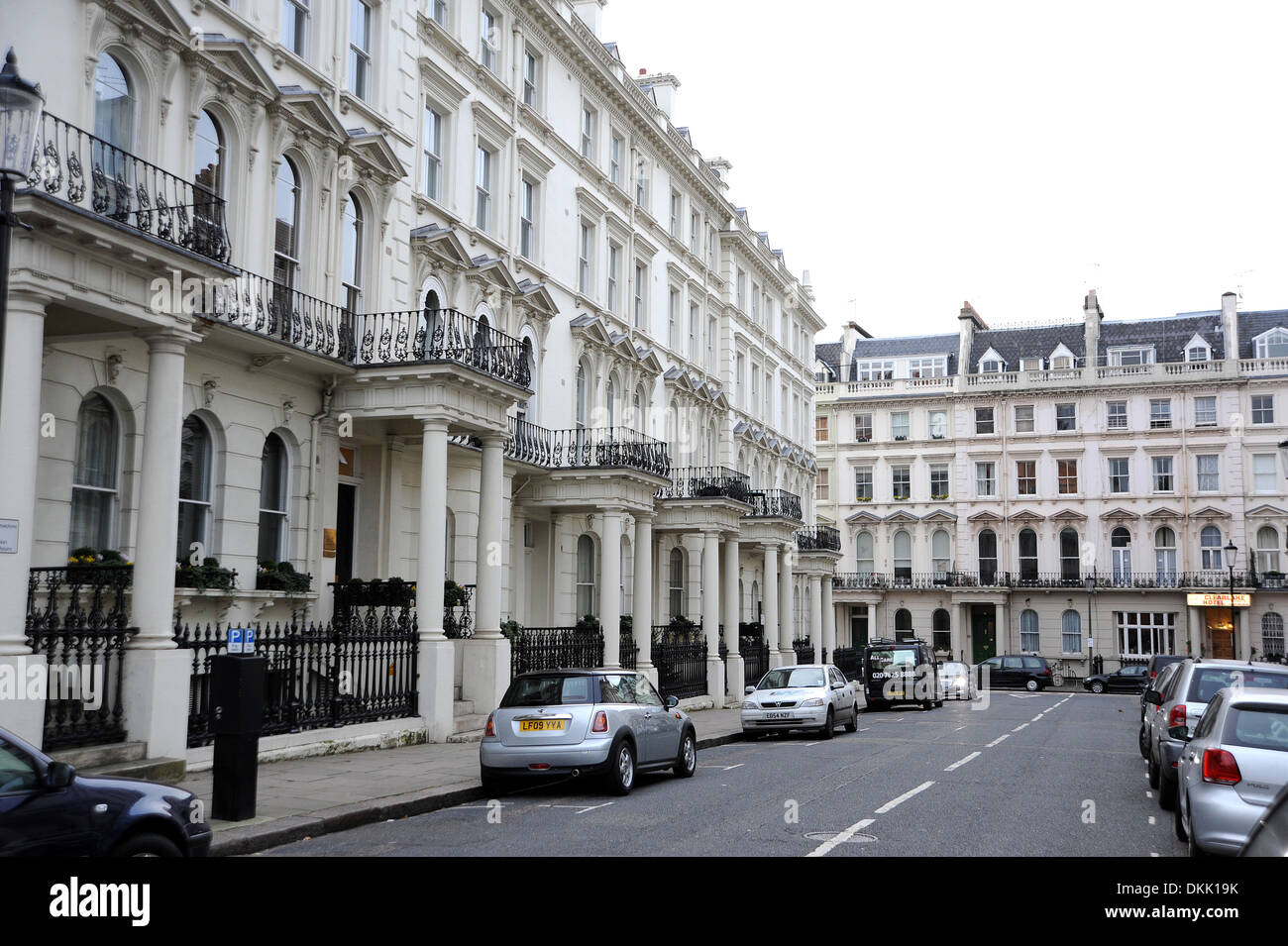 Typical large houses in the Royal Borough of Kensington and Chelsea London W8 UK Photograph taken by Simon Dack - Stock Image