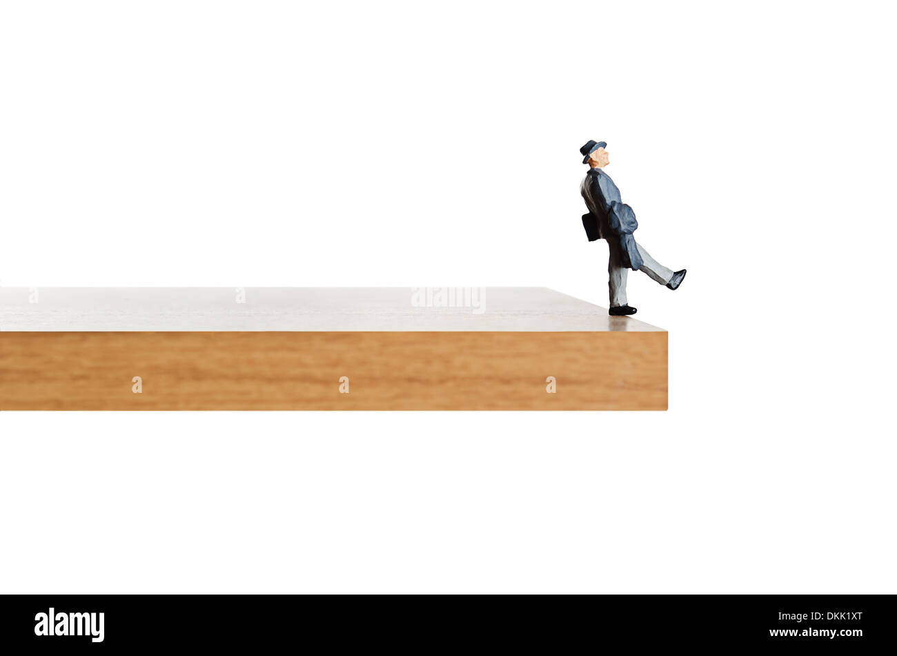 Walking off the edge. - Stock Image
