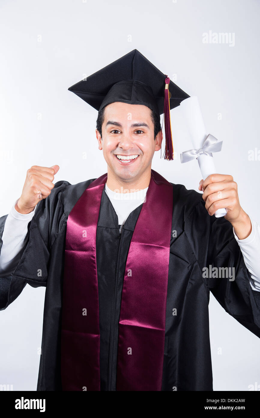 Smiling male graduate holding up diploma - Stock Image