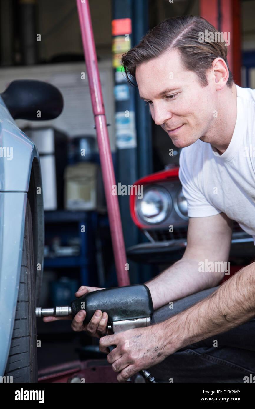 Male mechanic working on car - Stock Image