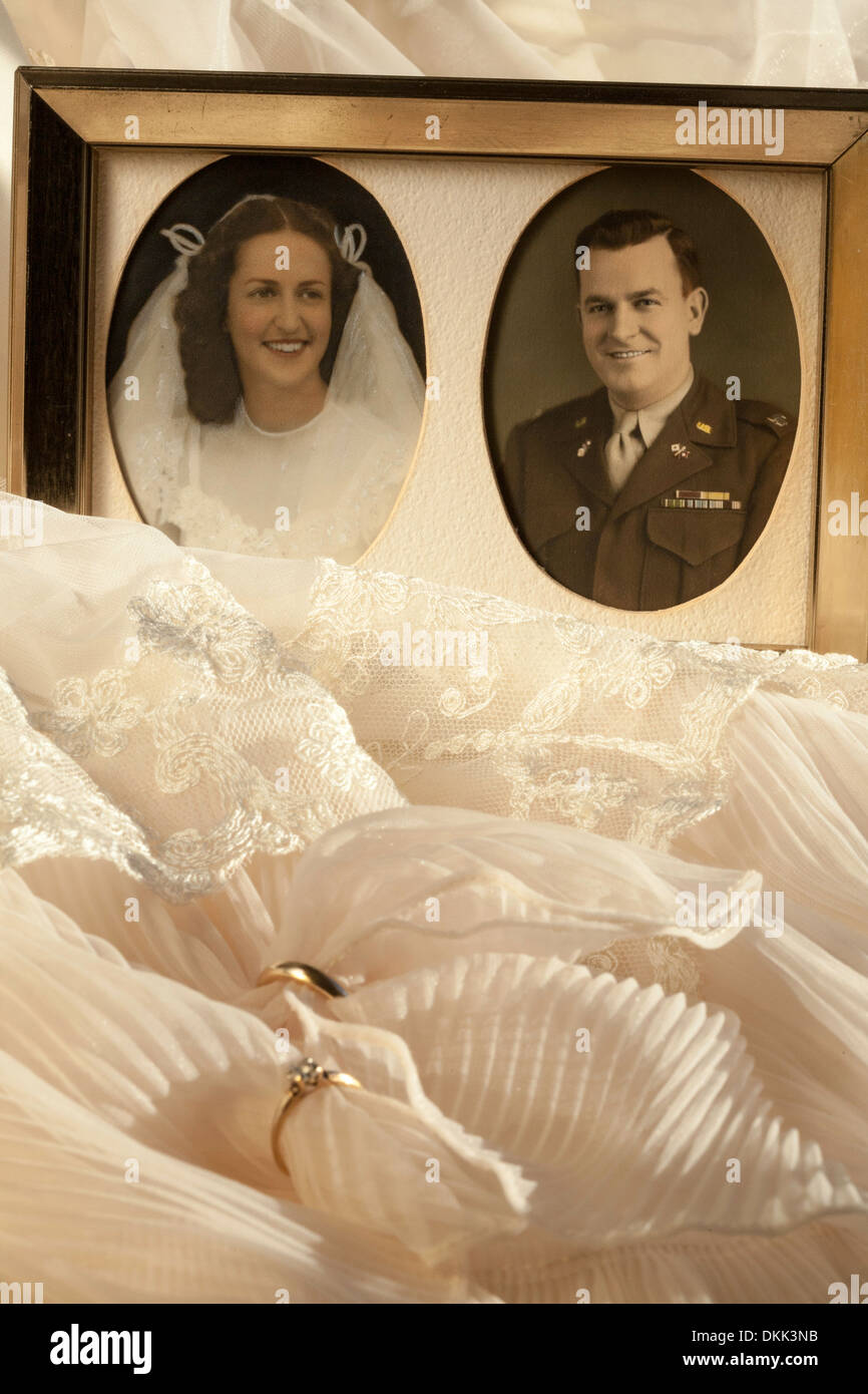 1946 Vintage Wedding Dress Rings And Photographs Still Life Stock