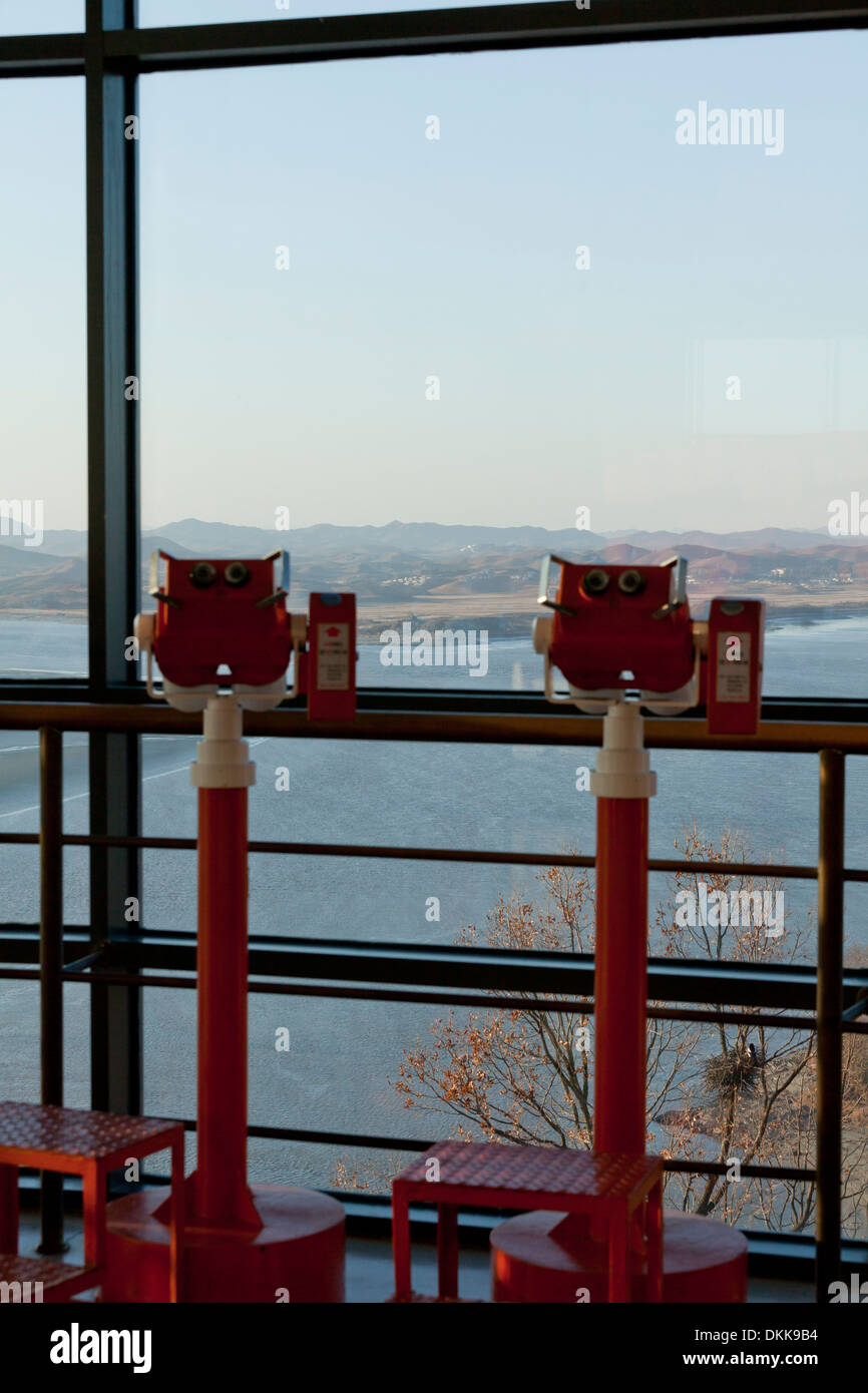 Coin operated binoculars point toward North Korea, over the Imjin river neutral zone (DMZ) - Odusan, South Korea - Stock Image