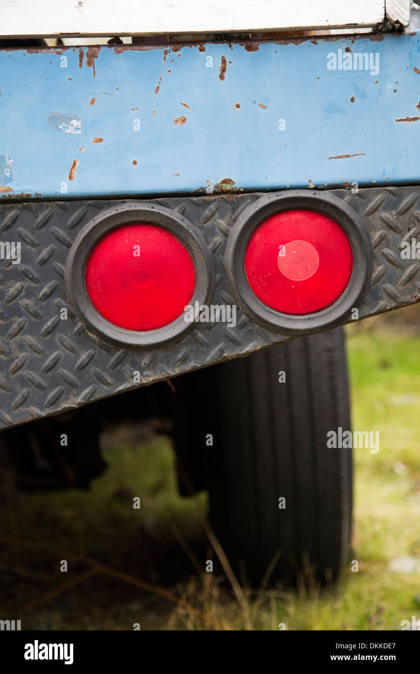 Blue work truck tail lights close-up - Stock Image