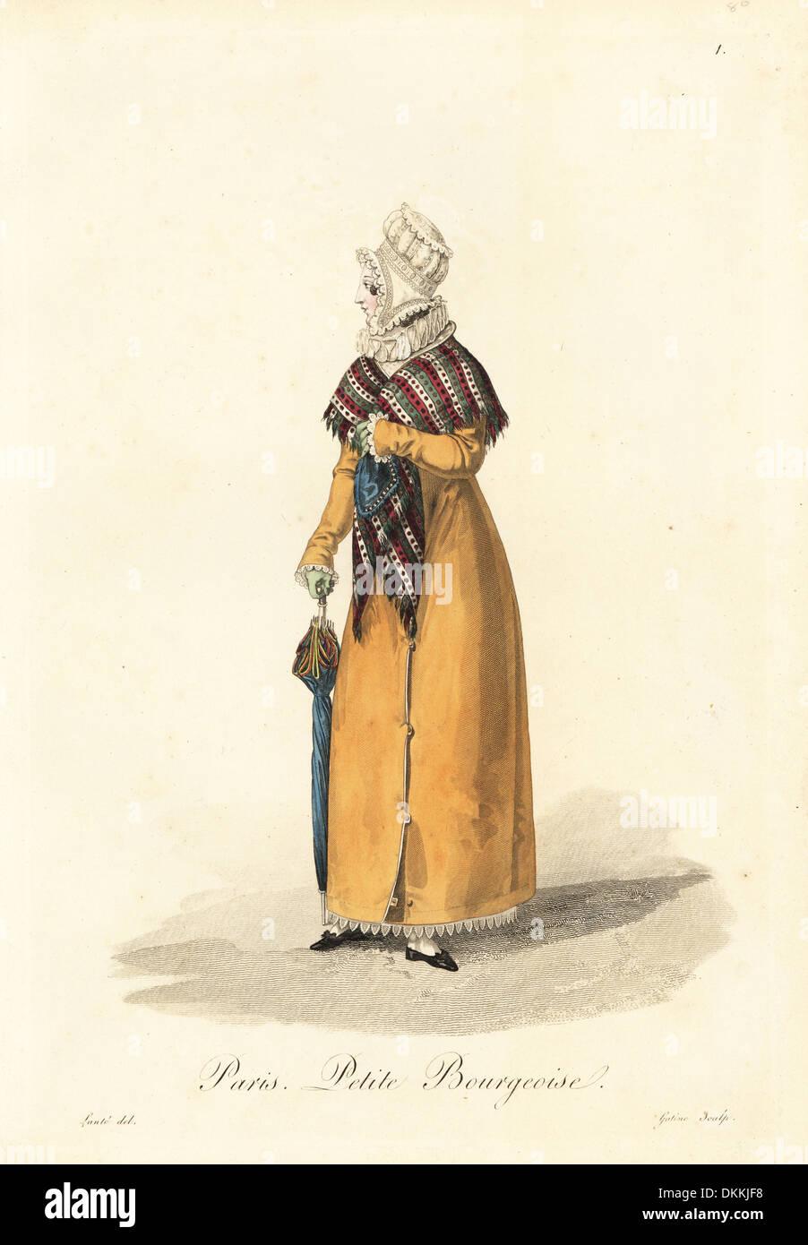 Petite bourgeoise woman of Paris carrying an umbrella. - Stock Image