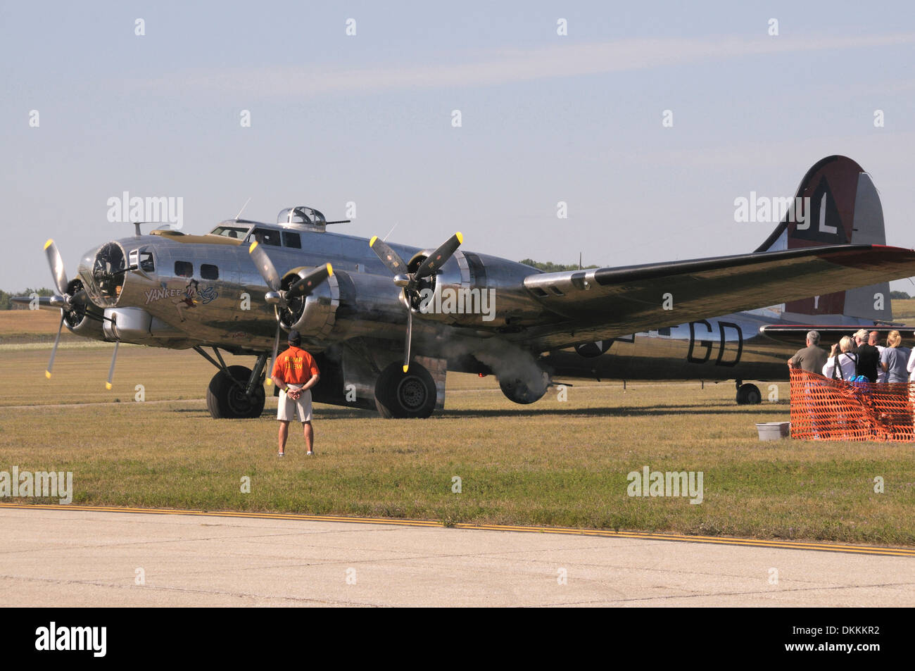 Boeng B1-17G Flying Fortress prepares to tke off for the air show in Bellville, Michigan while many look on Stock Photo