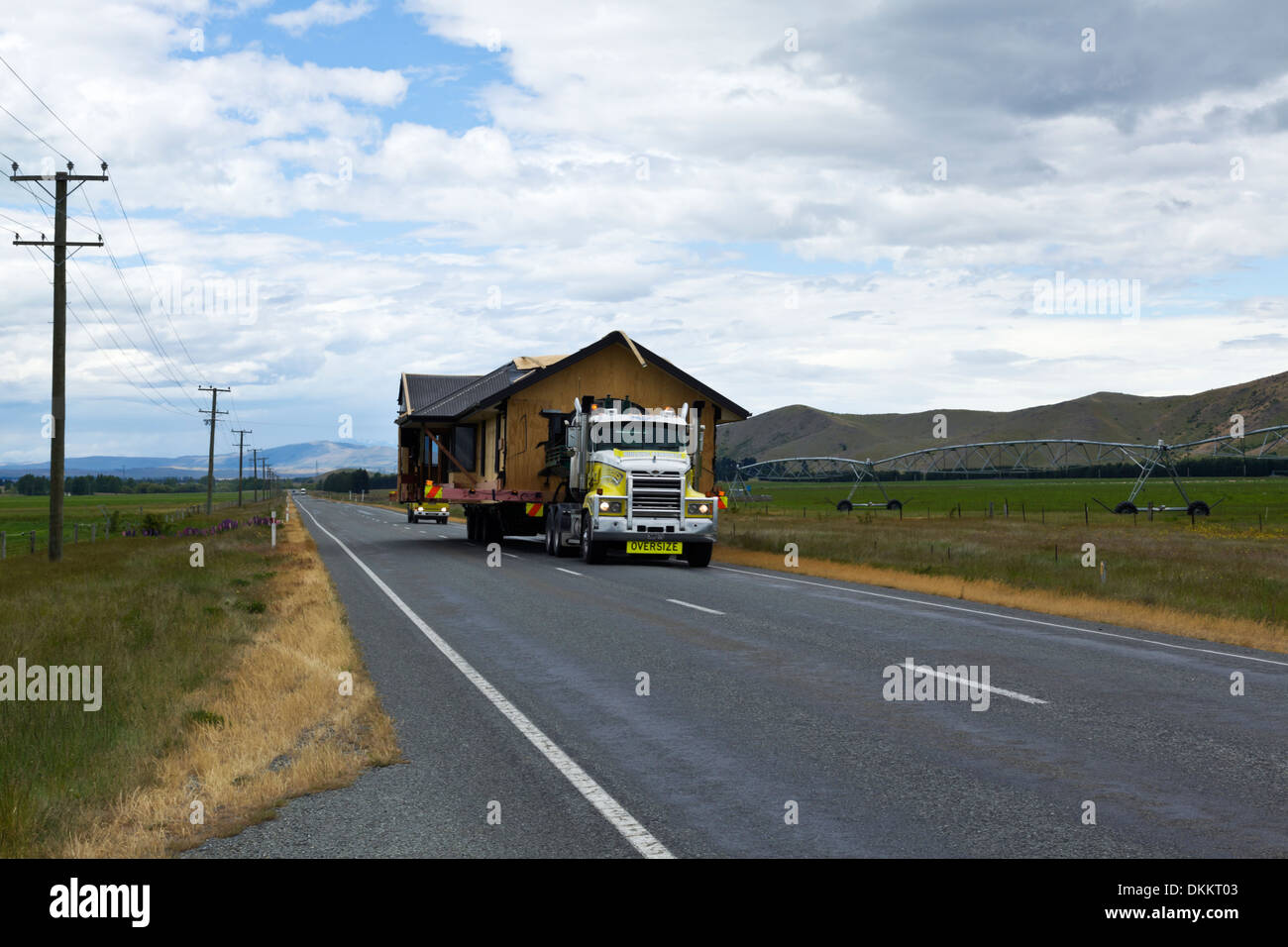 A new house is delivered on the back of this truck on the South Island of New Zealand Stock Photo
