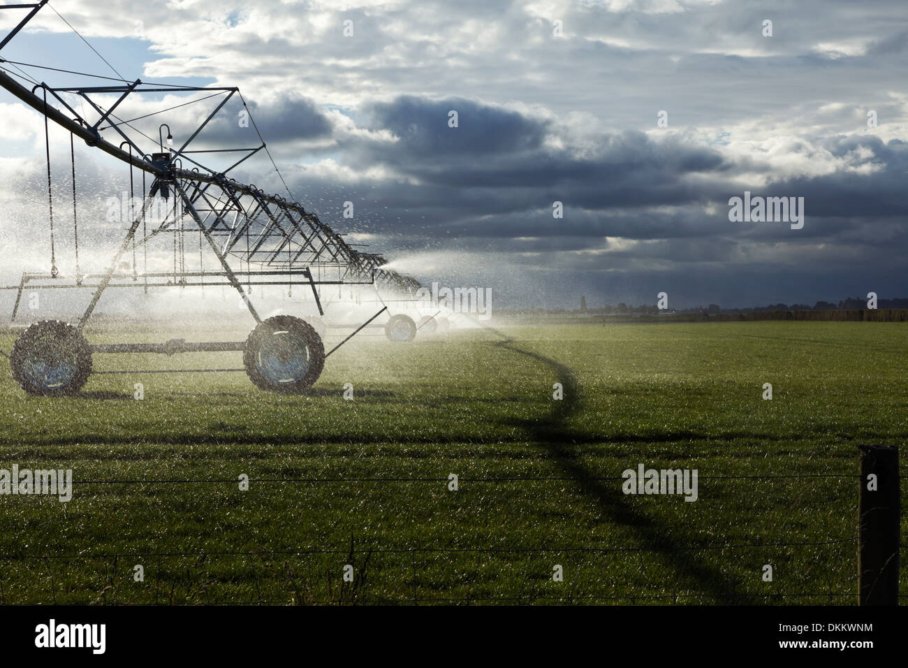 Irrigation booms spray water onto a pasture on the South Island of New Zealand - Stock Image
