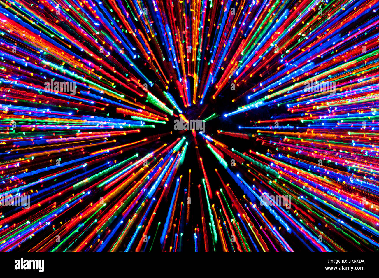 Christmas tree lights zoomed abstract; converging lines of light - Stock Image