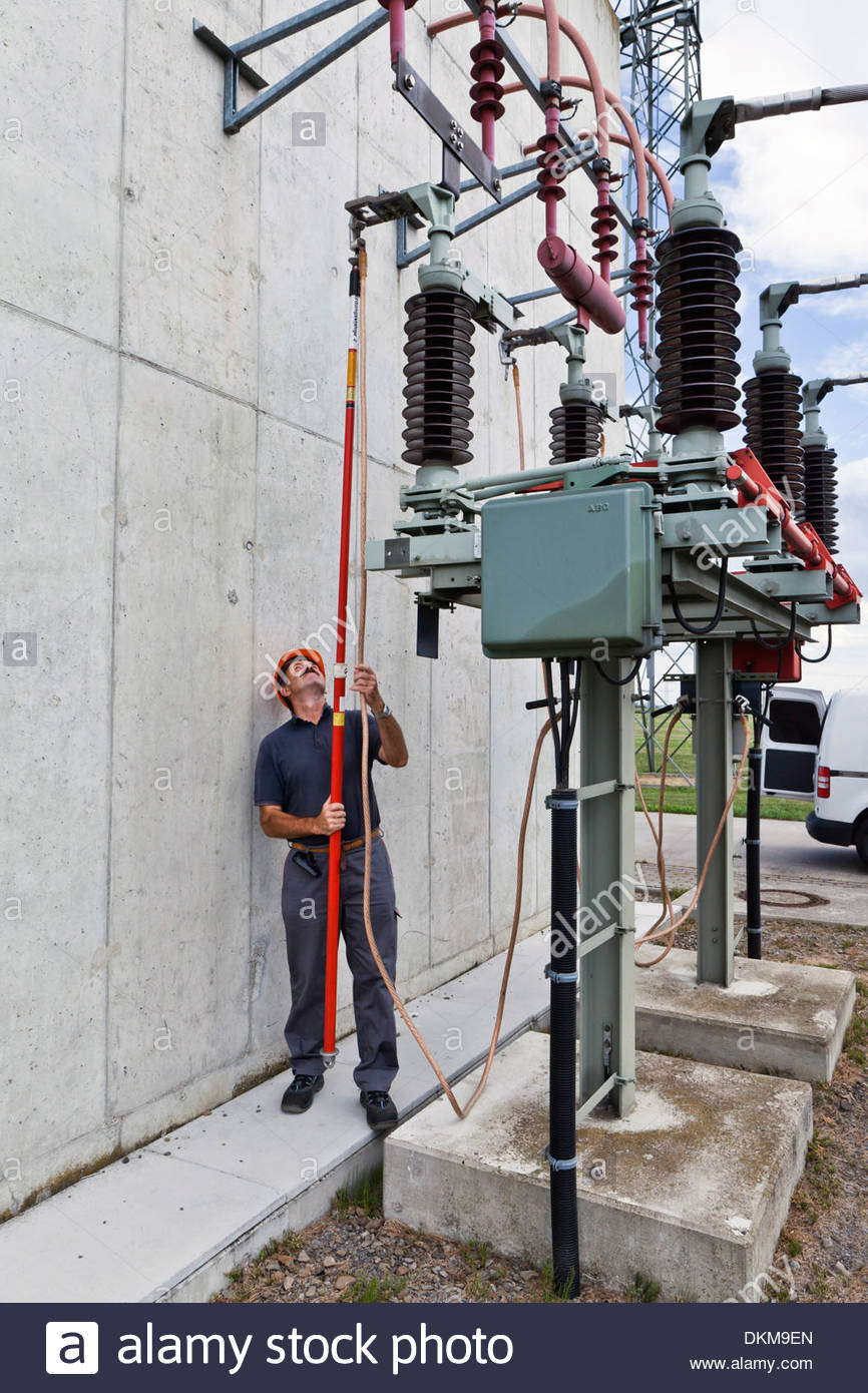 Electrician at maintenance work in a electrical substation Stock ...