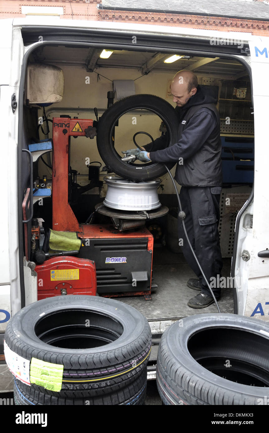 Kwik Fit Mobile Tyre Repair And Replacement Fitter Working On