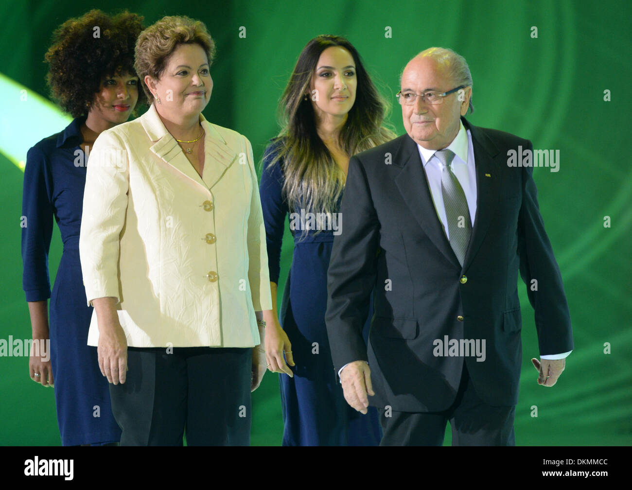 Costa do Sauipe, Bahia, Brazil. 06th Dec, 2013. Host Fernanda Lima (R-L) welcomes FIFA-president Sepp Blatter and President of Brazil, Dilma Rousseff, on the stage during the final draw for the preliminary round groups of the FIFA World Cup 2014 in Costa do Sauipe, Bahia, Brazil, 06 December 2013. Photo: Marcus Brandt/dpa/Alamy Live News - Stock Image