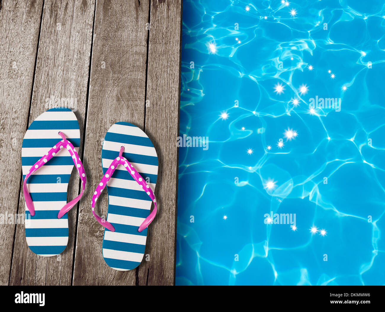 fe70d2659b40d7 flip flop sandals on old wooden boards near swimming pool Stock ...