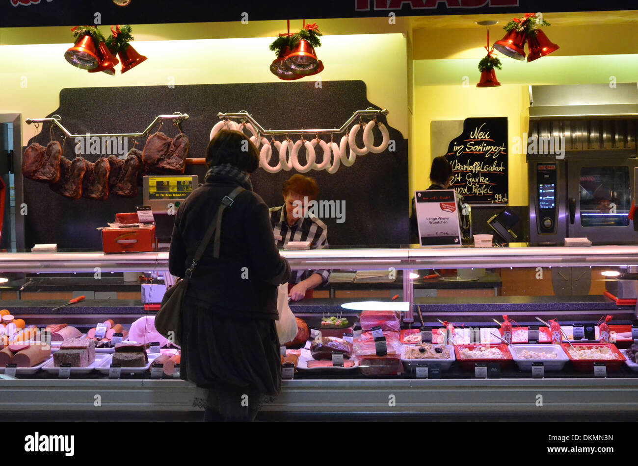 Berlin, Supermarket at Christmastime, shopping, sausages - Stock Image